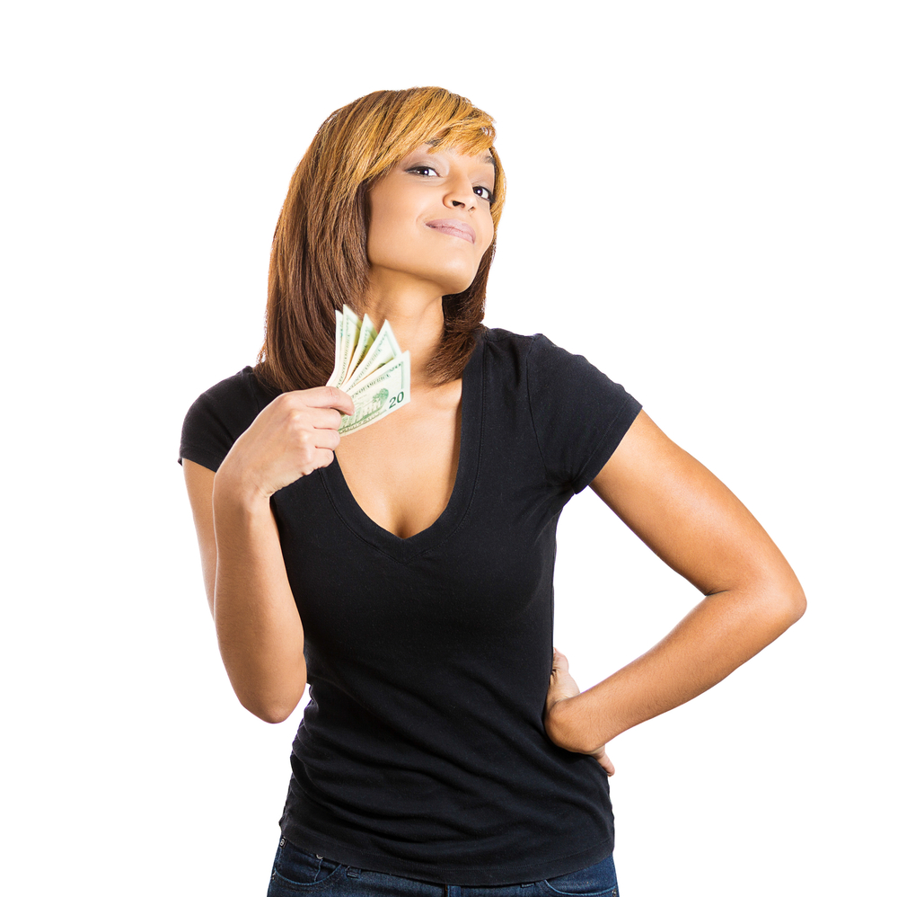 Closeup portrait of happy successful young woman holding money dollar bills in hand fanning her face, isolated on white background. Positive emotion facial expression feeling. Financial reward savings